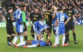 A Chelsea player goes down vs Barcelona.