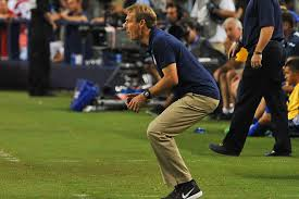 Coach Klinsmann actively watches