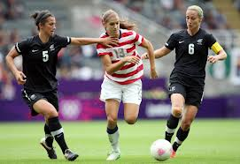 Alex Morgan beats two defenders with her speed and control