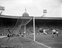 Tottenham scores against Leicester in the 1961 FA Cup final